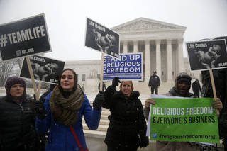 Top: Demonstrators rally Tuesday in front of the U.S. Supreme Court in Washington as the court began hearing oral arguments in challenges against President Barack Obama's health care law. Charles Dharapak -