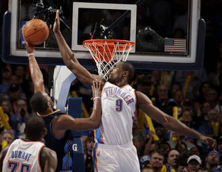 Oklahoma City's Serge Ibaka (9) blocks Denver's Arron Afflalo's shot during the NBA basketball game between the Oklahoma City Thunder and the Denver Nuggets at the Chesapeake Energy Arena, Sunday, Feb. 19, 2012. Photo by Sarah Phipps, The Oklahoman