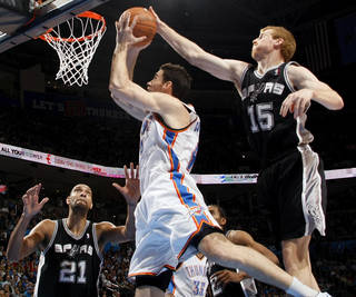 San Antonio's Matt Bonner (15) tries to block the shot of Oklahoma City's Nick Collison near San Antonio's Tim Duncan (21) during the NBA basketball game between the Oklahoma City Thunder and the San Antonio Spurs at Chesapeake Energy Arena in Oklahoma City, Friday, March 16, 2012. Photo by Nate Billings, The Oklahoman