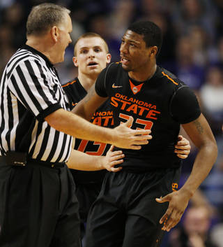 OSU's Marcus Smart, right, talks with an official after being called for a technical foul during a 74-71 loss to Kansas State on Saturday. AP Photo