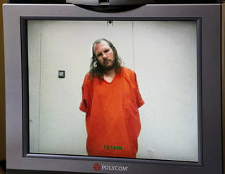FAMILY / RELATIVES / MURDERS: Accused of first-degree murder in the deaths of four people in a southwest Oklahoma City home last week, suspect Daniel Green, 40, wearing an orange jumpsuit, appeared before Oklahoma County Special Judge Russell Hall for a video arraignment in the Oklahoma County Courthouse on Monday, Aug. 19, 2013. Bail was denied. Green's arraignment lasted less than two minutes. The victims were identified as GreenÂ's mother, Sallie Green, 57; his sister, Rebecca Cizek, 34; and CizekÂ's children, Katherine Cizek, 16; and Amario Dominguez III, an infant. All were killed inside the family's home, 4601 SE 79. Photo by Jim Beckel, The Oklahoman.