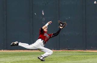 Putnam City North's Garrett Perez (8) makes a catch for an out in the outfield during the Class 6A baseball state tournament game between Puntnam City North and Bishop Kelley at the University of Oklahoma in Norman, Okla. on Thursday, May 15, 2014. Photo by Chris Landsberger, The Oklahoman
