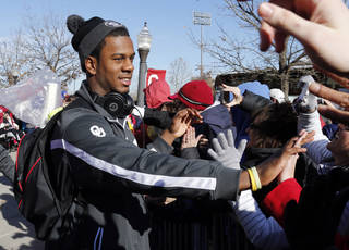 Julian Wilson and Sooner team members are greeted by several hundred fans gathered to welcome the University of Oklahoma Sooner (OU) football team as they return victorious from the Sugar Bowl on Friday, Jan. 3, 2014 in Norman, Okla. Photo by Steve Sisney, The Oklahoman