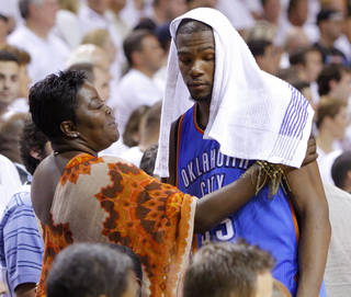 Oklahoma City's Kevin Durant talks with his mother Wanda Pratt near the end of Game 5 of the NBA Finals between the Oklahoma City Thunder and the Miami Heat in June 2012 at American Airlines Arena in Miami. BRYAN TERRY - BRYAN TERRY