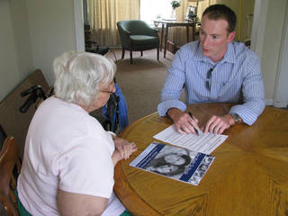 A volunteer offers legal assistance to a senior. Photo provided
