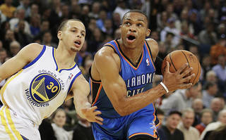 Oklahoma City Thunder's Russell Westbrook, right, drives past Golden State Warriors' Stephen Curry (30) during the first half of an NBA basketball game, Wednesday, Jan. 23, 2013, in Oakland, Calif. (AP Photo/Ben Margot)