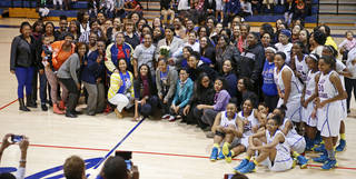 Longtime Millwood girls basketball coach Arnelia Spears poses for a group photo with current and former players after a group photo following her last regular season home game at Millwood in Oklahoma City, Tuesday, Feb., 11, 2014. Photo by Bryan Terry, The Oklahoman