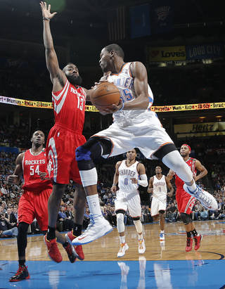 Oklahoma City 's Kevin Durant (35) drives past Houston's James Harden (13) during the NBA basketball game between the Houston Rockets and the Oklahoma City Thunder at the Chesapeake Energy Arena on Wednesday, Nov. 28, 2012, in Oklahoma City, Okla. Photo by Chris Landsberger, The Oklahoman