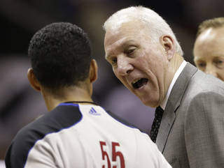 San Antonio Spurs' Gregg Popovich talks to official referee Bill Kennedy (55) against the Miami Heat during the first half at Game 4 of the NBA Finals basketball series, Thursday, June 13, 2013, in San Antonio. (AP Photo/Eric Gay)