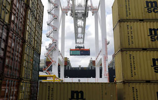 In this March 1 photo, a crane removes a container from a ship at the Port of Baltimore's Seagirt Marine Terminal in Baltimore. The government issues its third and final estimate of economic growth in the January-March quarter, Wednesday. AP Photo/Patrick Semansky, File Patrick Semansky - AP