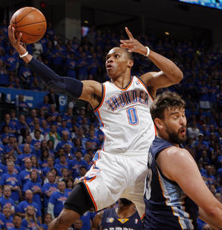 Oklahoma City's Russell Westbrook (0) takes the ball to the hoop past Marc Gasol (33) of Memphis in the first half during game 7 of the NBA basketball Western Conference semifinals between the Memphis Grizzlies and the Oklahoma City Thunder at the OKC Arena in Oklahoma City, Sunday, May 15, 2011. Photo by Nate Billings, The Oklahoman