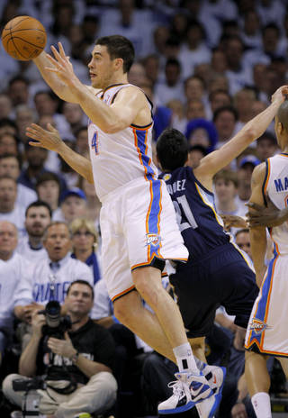 Oklahoma City's Nick Collison (4) grabs the ball in front of Greivis Vasquez (21) of Memphis during game five of the Western Conference semifinals between the Memphis Grizzlies and the Oklahoma City Thunder in the NBA basketball playoffs at Oklahoma City Arena in Oklahoma City, Wednesday, May 11, 2011. Photo by Bryan Terry, The Oklahoman