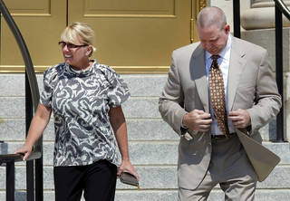 Lauri Ann Parsons, left, and her husband, Brent Alan Parsons, leave the U.S. Federal Courthouse in Muskogee, OK, on Monday, Aug. 5, 2013, after Lauri Parsons pleaded guilty to charges against her that were unsealed earlier in the morning. Brent was to have his hearing on the same charges later in the day. Photo by Michael Wyke, Tulsa World Michael Wyke - AP