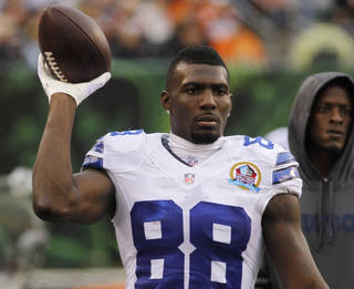 Dallas Cowboys wide receiver Dez Bryant tosses a football on the sidelines in the second half of an NFL football game against the Cincinnati Bengals, Sunday, Dec. 9, 2012, in Cincinnati. (AP Photo/Tom Uhlman) ORG XMIT: NYOTK
