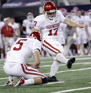 Oklahoma's Jimmy Stevens (17) kicks the game-winning field goal to put the Sooners up 23-20 over Nebraska during the Big 12 football championship game between the University of Oklahoma Sooners (OU) and the University of Nebraska Cornhuskers (NU) at Cowboys Stadium on Saturday, Dec. 4, 2010, in Arlington, Texas. Photo by Chris Landsberger, The Oklahoman
