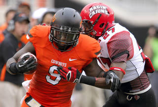 Oklahoma State's Kye Staley (9) tries to get by Louisiana-Lafayette's T.J. Worthy (27) during a college football game between Oklahoma State University (OSU) and the University of Louisiana-Lafayette (ULL) at Boone Pickens Stadium in Stillwater, Okla., Saturday, Sept. 15, 2012. Photo by Sarah Phipps, The Oklahoman