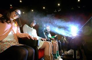 NAGOYA, JAPAN - APRIL 22: (CHINA OUT, SOUTH KOREA OUT) Panel in front of the seats sprays water mist to the audience at 4DX-equipped theater during a press preview at Nakagawa Korona World on April 22, 2013 in Nagoya, Aichi, Japan.The newly arrived technology delivers smells, seat motions, strobe lights and fog, all in sync with events as they appear on the screen. (Photo by The Asahi Shimbun via Getty Images)