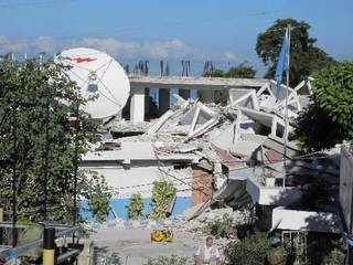 In this Wednesday, Jan. 13, 2010 photo released by the Philippine Mission to the United Nations, police officers from the United Nations inspect what was left of the United Nations Police Headquarters in Port-au-Prince, a day after a 7.0-magnitude quake shook Haiti. (AP Photo/Philippine Mission to the United Nations)
