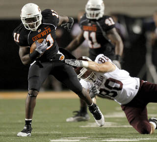 OSU's Shaun Lewis (11) returns an interception as A&M's Hutson Prioleau (80) tackles him late in the fourth quarter during the college football game between Texas A&M University (TAMU) and Oklahoma State University (OSU) at Boone Pickens Stadium in Stillwater, Okla., Thursday, Sept. 30, 2010. Photo by Sarah Phipps, The Oklahoman