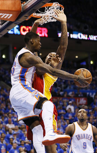 NBA BASKETBALL: Oklahoma City's DeAndre Liggins (25) passes around Houston's Greg Smith (4) as Oklahoma City's Serge Ibaka (9) looks on in the second half during Game 5 in the first round of the NBA playoffs between the Oklahoma City Thunder and the Houston Rockets at Chesapeake Energy Arena in Oklahoma City, Wednesday, May 1, 2013. Houston won, 107-100. Photo by Nate Billings, The Oklahoman
