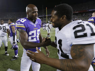 Minnesota Vikings running back Adrian Peterson (28) shakes hands with Oakland Raiders running back Maurice Jones-Drew (21) after a preseason NFL football game at TCF Bank Stadium in Minneapolis, Friday, Aug. 8, 2014. Minnesota won 10-6. (AP Photo/Ann Heisenfelt)