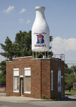 The Braums Milk bottle building at 2426 N Classen is being restored to its original appearance. The tiny, triangular building was constructed in 1930 to serve streetcar riders. The iconic milk bottle was added in 1948. Photo By Steve Gooch, The Oklahoman Archives Steve Gooch - The Oklahoman