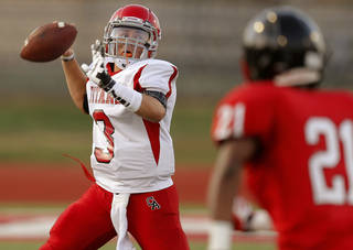 Carl Albert's Stevie Thompson throws a pass during a high school football scrimmage between Del City and Carl Albert in Del City, Okla., Friday, August 23, 2013. Photo by Bryan Terry, The Oklahoman