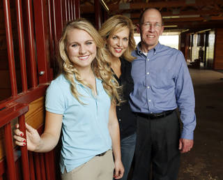 Molly Remondino, 17, her mother, Denise Remondino and Jim Quade, Peppers Ranch executive director, are shown at the stables at Peppers Ranch foster care community near Guthrie. Photo by Nate Billings, The Oklahoman NATE BILLINGS