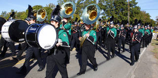 Norman North High School's marching band performs with the Norman High School marching band at a Veterans Day parade. OKLAHOMAN ARCHIVES PAUL B. SOUTHERLAND