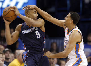 Oklahoma City 's Andre Roberson (21) defends against Charlotte Gerald Henderson (9) during the NBA basketball game between the Oklahoma City Thunder and the Charlotte Bobcats at the Chesapeake Energy Arena, Sunday, March 2, 2014. Photo by Sarah Phipps, The Oklahoman