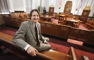 """Criminal defense attorney Kent Bridge left the public defender's office after 14 years to go into private practice. """"Every week you get 10 new clients, and that never stops,"""" Kent said. """"If you don't close 10 cases a week, your caseload goes up."""" Photo by Paul B. Southerland, The Oklahoman"""