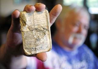 """Jack Precht on Thursday holds a Bible that belonged to his Marine buddy Dan Arthur """"Art"""" Bolton. Precht has searched for decades for Bolton's family to give them the Bible and a watch face that he has had since 1969. CORY YOUNG/Tulsa World"""