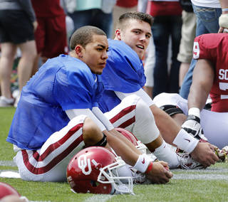 Kendal Thompson, left, and Blake Bell warm up before the annual Spring Football Game at Gaylord Family-Oklahoma Memorial Stadium in Norman, Okla., on Saturday, April 13, 2013. Photo by Steve Sisney, The Oklahoman