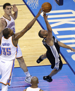 Oklahoma City's Kevin Durant blocks the shot of San Antonio's Tony Parker during Game 4 of the Western Conference Finals in the NBA playoffs between the Oklahoma City Thunder and the San Antonio Spurs at Chesapeake Energy Arena in Oklahoma City, Tuesday, May 27, 2014. Photo by Bryan Terry, The Oklahoman