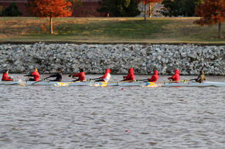 The crew from US Grant High School heads to the finish line to win their 500 meter heat race in a time of 2:04 in during the OKC Riversport Youth League Championship on the Oklahoma River in downtown Oklahoma City, Wednesday, November 16, 2011. PHOTO BY HUGH SCOTT, FOR THE OKLAHOMAN