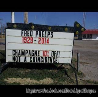 A marquee in front of Moore Liquor at 914 SW 4 promises a sale on champagne to celebrate the death of Westboro Baptist Church founder Fred Phelps. - Facebook