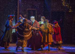 """Christopher Bloch, center, an actor based in Washington, D.C., makes his Lyric Theatre of Oklahoma debut playing Ebenezer Scrooge in Lyric's third annual production of """"A Christmas Carol."""" Photo provided."""