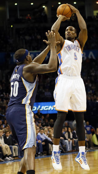 Oklahoma City's Serge Ibaka (9) shoots against Memphis' Zach Randolph (50) in the first half during an NBA basketball game between the Oklahoma City Thunder and the Memphis Grizzlies at Chesapeake Energy Arena in Oklahoma City, Monday, Feb. 3, 2014. Photo by Nate Billings, The Oklahoman