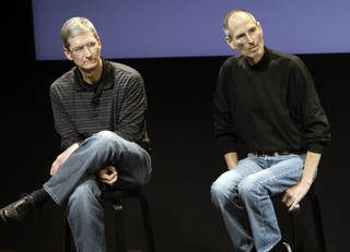 This 2010 file photo shows Apple's Tim Cook, left, and Steve Jobs, during a meeting at Apple in Cupertino, Calif. Apple's potential purchase of headphone maker Beats Electronics for $3.2 billion is just the latest example of how much Cook has deviated from Jobs, who had so much confidence in his company's innovative powers that he saw little sense in spending a lot of money on acquisitions. AP Photo Paul Sakuma - AP