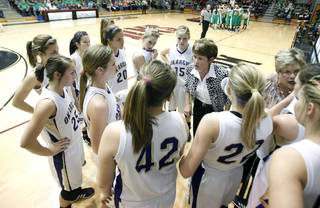 Okarche Head Coach Cherie Myers talks to her players during the girl's class A basketball playoffs against Stonewall at Southern Nazarene University's Sawyer Center in Bethany, OK, Thursday, March 1, 2012. By Paul Hellstern, The Oklahoman