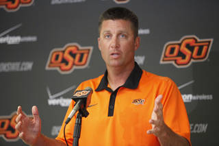 OKLAHOMA STATE UNIVERSITY / OSU / COLLEGE FOOTBALL: Oklahoma State head football coach Mike Gundy talks with reporters during a press conference at Boone Pickens Stadium in Stillwater , Thursday, August 25, 2011. Photo by Steve Gooch ORG XMIT: KOD