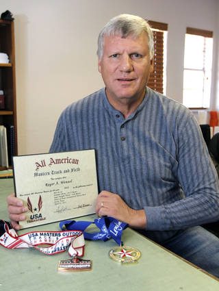 Roger Wenzel shows some ribbons and a certificate which he has won in senior-adult track-and-field events. Oklahoma City, OK, Monday, March 4, 2013. Wenzel has Parkinson's disease, and managing the disease means taking testosterone, which has gotten him in trouble with the U.S. Anti Doping Agency. By Paul Hellstern, The Oklahoman