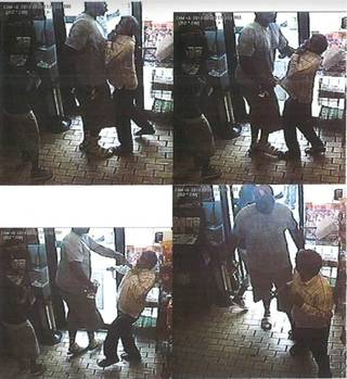 Stills released by the Ferguson (Mo.) Police Dept. from surveillance video that appear to show a confrontation at a convenience store.