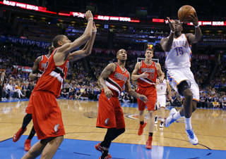 Oklahoma City's Reggie Jackson (15) goes up for a layup during the NBA basketball game between the Oklahoma City Thunder and the Portland Trail Blazers at the Chesapeake Energy Arena in Oklahoma City, Sunday, March, 24, 2013. Photo by Sarah Phipps, The Oklahoman