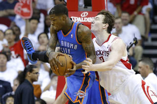 Oklahoma City's DeAndre Liggins grabs a rebound beside Houston's Omer Asik during Game 3 in the first round of the NBA playoffs between the Oklahoma City Thunder and the Houston Rockets at the Toyota Center in Houston, Texas, Saturday, April 27, 2013. Photo by Bryan Terry, The Oklahoman