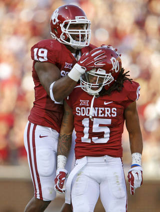 Oklahoma's Eric Striker (19) and Zack Sanchez (15) celebrate after Sanchez blocked a field goal attempt during a college football game between the University of Oklahoma Sooners (OU) and the Louisiana Tech Bulldogs at Gaylord Family-Oklahoma Memorial Stadium in Norman, Okla., on Saturday, Aug. 30, 2014. Photo by Bryan Terry, The Oklahoman