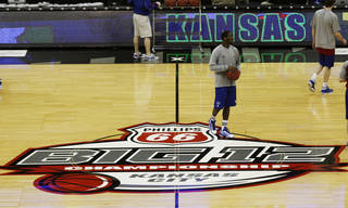 Kansas guard Tyshawn Taylor stands at halfcourt of the Sprint Center during practice for the Big 12 NCAA college basketball tournament on Wednesday, March 7, 2012, in Kansas City, Mo. (AP Photo/Orlin Wagner) Orlin Wagner