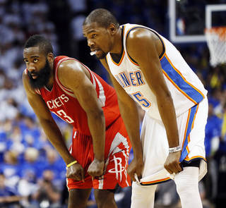 Houston's James Harden (13) and Kevin Durant (35) rest their hands on their knees during Game 2 in the first round of the NBA playoffs between the Oklahoma City Thunder and the Houston Rockets at Chesapeake Energy Arena in Oklahoma City, Wednesday, April 24, 2013. Oklahoma City won, 105-102. Photo by Nate Billings, The Oklahoman