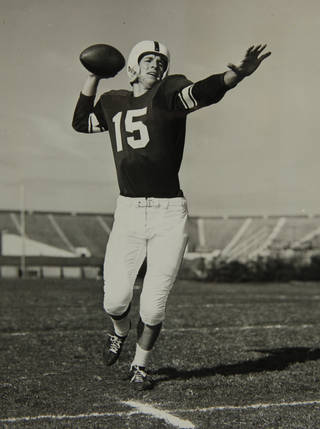 """Jim Harris, sophomore quarterback, replaced injured Gene Calame to direct the Oklahoma Sooners to a 14-7 triumph over Texas Saturday. The victory enabled the Sooners to retain their No.1 ranking in the Associated Press football poll after earlier decisions over California and TCU."" (AP Wirephoto) Photo arrived in library on 10/19/1954. Copy photo of OU quarterback Jimmy Harris -- ORG XMIT: KOD"