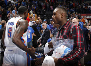 Trey Johnson greets Oklahoma City's Kendrick Perkins (5) following the NBA game between the Oklahoma City Thunder and the Boston Celtics at the Chesapeake Energy Arena in Oklahoma City, Sunday, March 10, 2013. Photo by Sarah Phipps, The Oklahoman